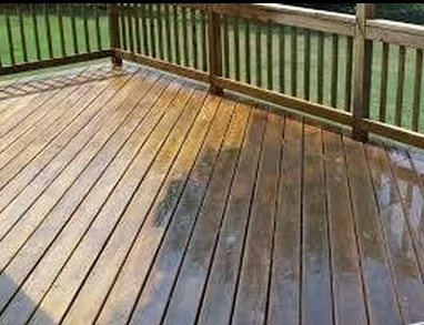 cleaning the deck with the pressure washer
